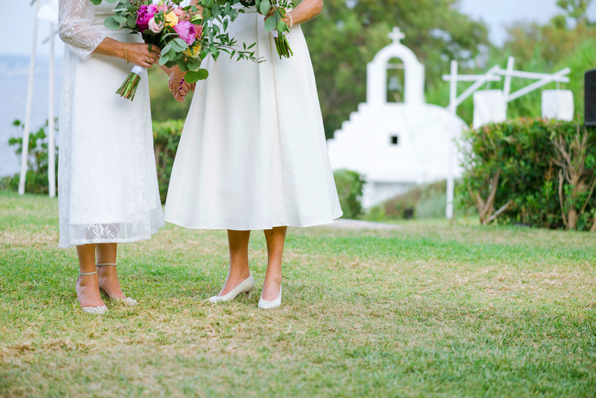 lesbian couple holding their wedding bouquets