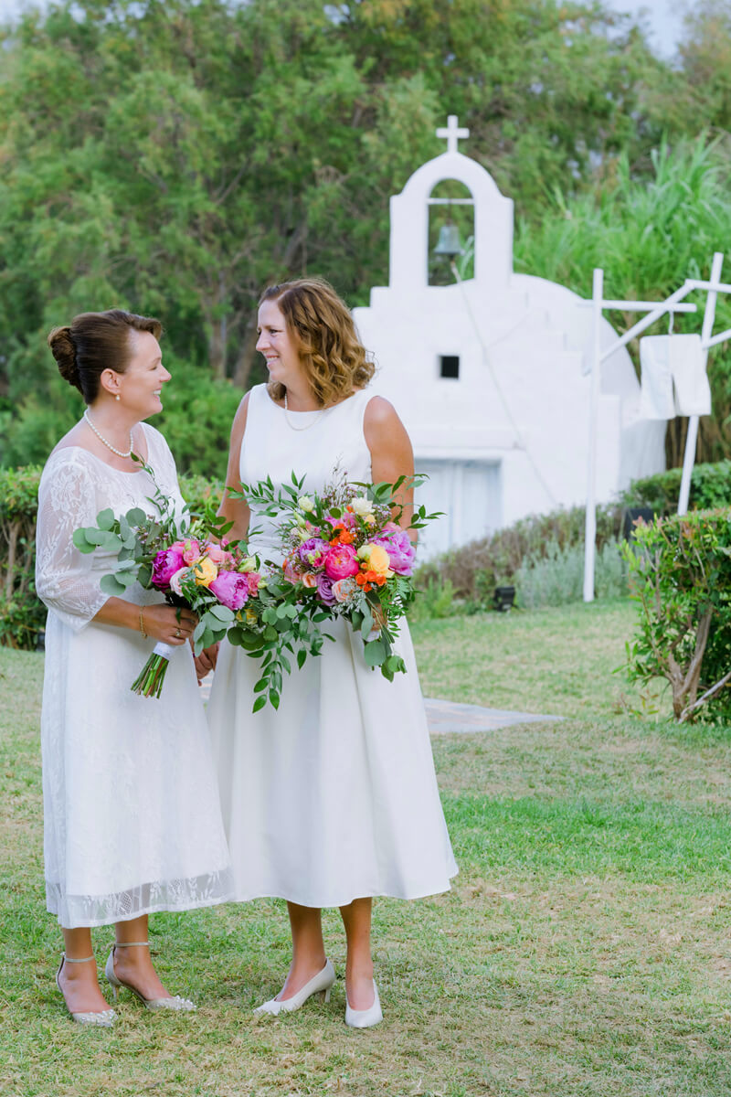 lesbian couple looking each other during their wedding photo shooting