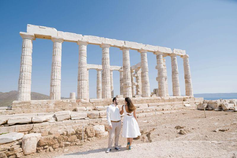 couple at Poseidon Temple, Sounio, Greece