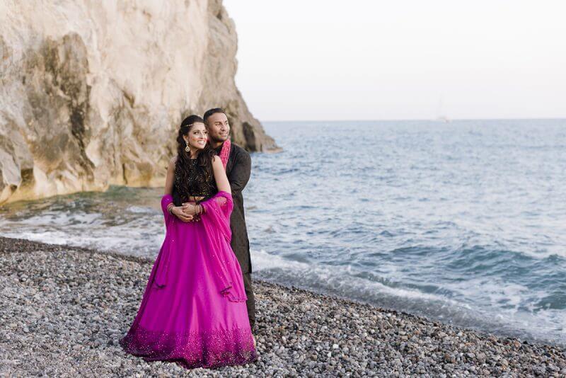 couple posing at red beach at Santorini