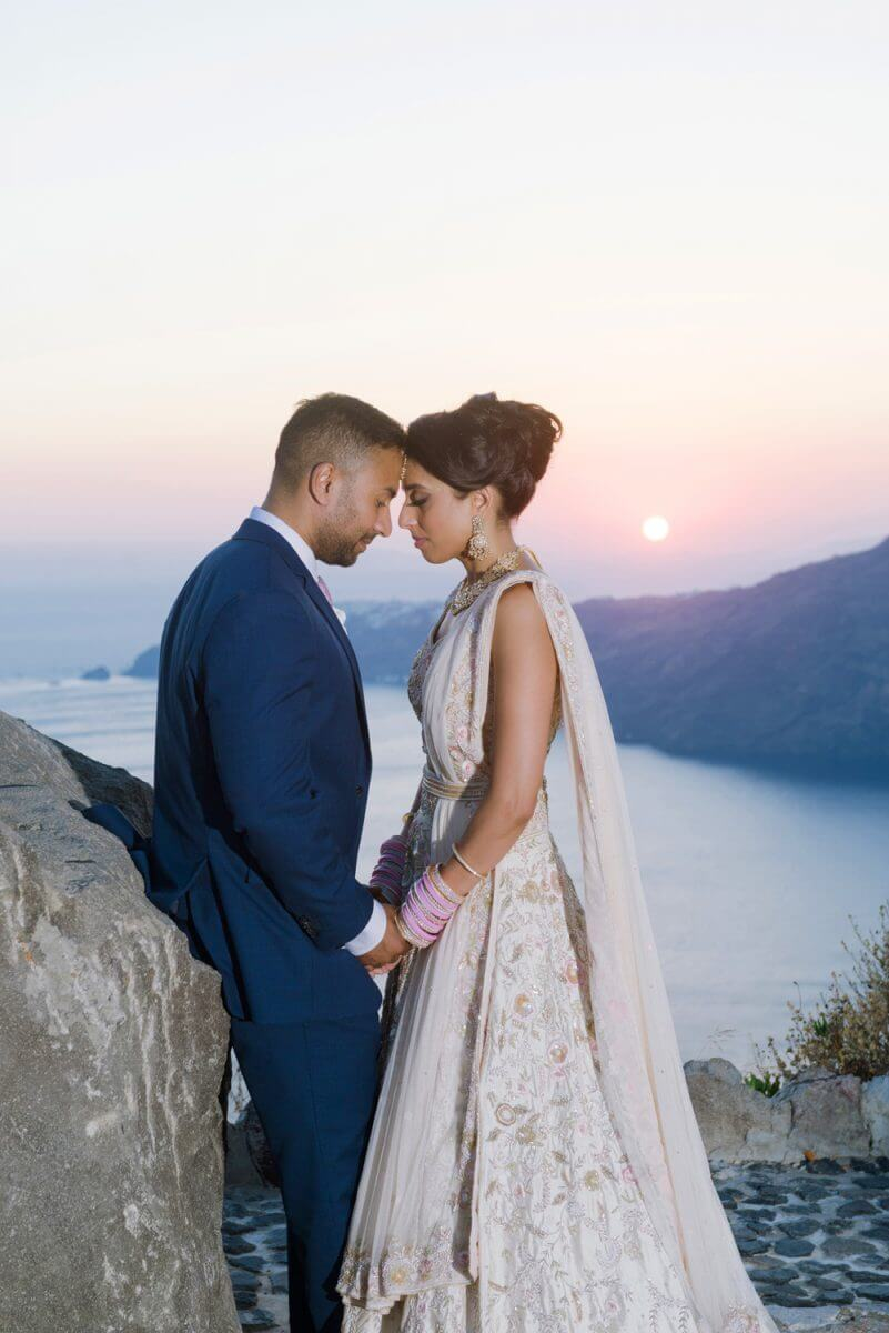 indian couple posing after their wedding in Santorini