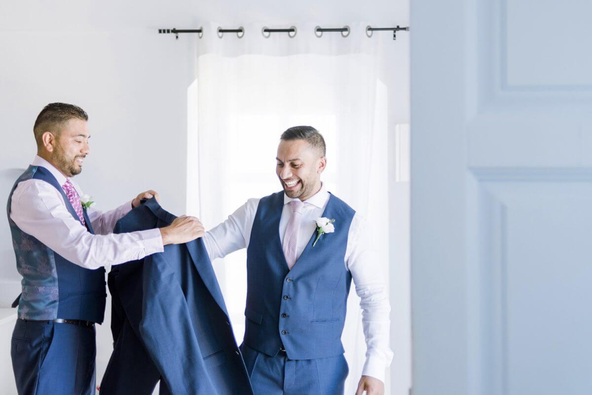 handsome groom wearing his suit