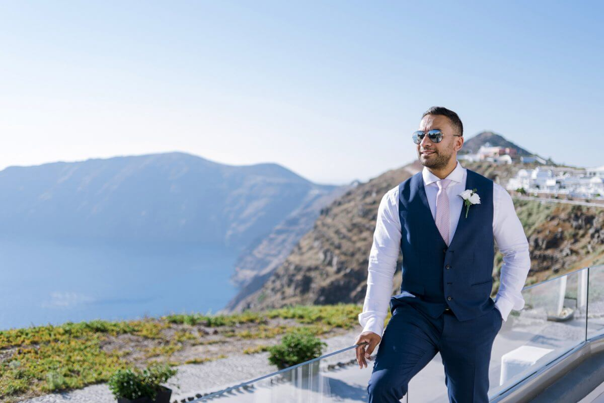 groom posing before the wedding ceremony at Santorini Greece