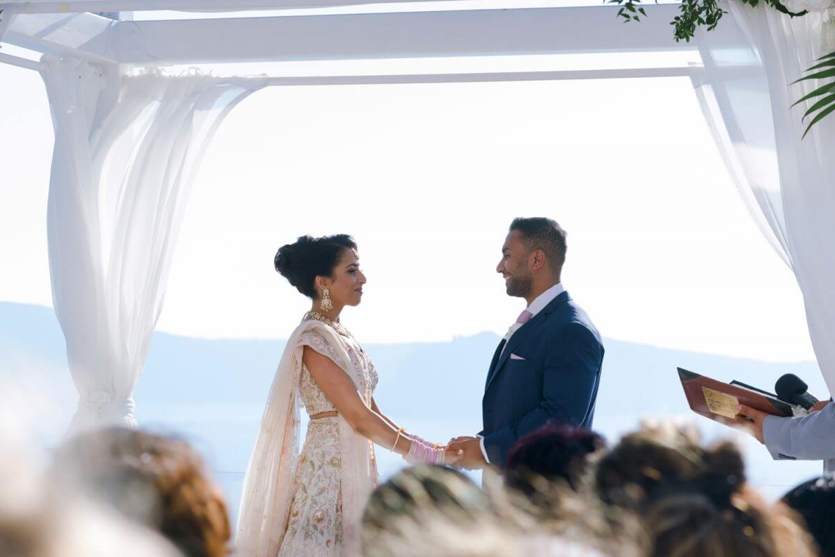 indian couple at their wedding ceremony at Santorini Greece